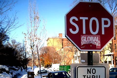 A vandalized global warming sign - Commons